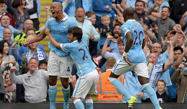 Vincent Kompany celebrates scoring against arch rival Chelsea